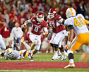 Nov 12, 2011; Fayetteville, AR, USA;  Arkansas Razorbacks Tyler Wilson (8) looks to make a pass as offensive guard Alvin Bailey (67) blocks and Tennessee Volunteers defensive linemen Willie Bohannon (86) and linebacker Austin Johnson (40) look on during a game at Donald W. Reynolds Razorback Stadium. Arkansas defeated Tennessee 49-7. Mandatory Credit: Beth Hall-US PRESSWIRE