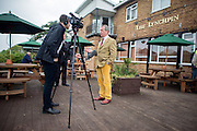 © Licensed to London News Pictures. 29/04/2014. Slough, UK. Nigel Farage gives a TV interview outside The Lynchpin pub.  NIGEL FARAGE leader of UKIP in Slough today 29 April 2014 to congratulate local activists on more than doubling the candidates the party will field in local elections. Photo credit : Stephen Simpson/LNP