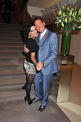 NANCY DELL'OLIO and CRAIG REVEL HORWOOD at the Lighthouse Gala Auction in aid of The Terrence Higgins Trust held at Christie's, 8 King Street, St.James' London on 19th March 2012.