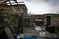 Dr David Binnie working on his new property on the the Inner Hebridean island of Colonsay on Scotland's west coast.  The island is in the council area of Argyll and Bute and has an area of 4,074 hectares (15.7 sq mi). Aligned on a south-west to north-east axis, it measures 8 miles (13 km) in length and reaches 3 miles (4.8 km) at its widest point, in 2019 it had a permanent population of 136 adults and children.