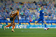 AFC Wimbledon defender Ben Heneghan (22) passing the ball during the EFL Sky Bet League 1 match between AFC Wimbledon and Hull City at Plough Lane, London, United Kingdom on 27 February 2021.