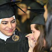Fatimah Ali (left) and Talia Chavez show emotion at graduation as President Bill Clinton addresses graduates of UCF's College of Health and Public Affairs and the College of Medicine's Burnett School of Biomedical Sciences at the UCF Arena on Thursday, May 2, 2013 in Orlando, Florida. Clinton was also awarded an honorary degree that  recognizes his service as president and also his service as a humanitarian and international ambassador since he left office. This is his third visit to the UCF campus and he will be the second U.S. president to speak at a UCF graduation ceremony. President Richard M. Nixon addressed graduates in 1973.  (AP Photo/Alex Menendez)