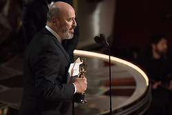 March 4, 2018 - Hollywood, California, U.S. - Mark Bridges accept the Oscar for Achievement in costume design, for work on Phantom Thread during the live ABC Telecast of The 90th Oscars at the Dolby Theatre in Hollywood. (Credit Image: ? Scott Diussa/AMPAS via ZUMA Wire/ZUMAPRESS.com)