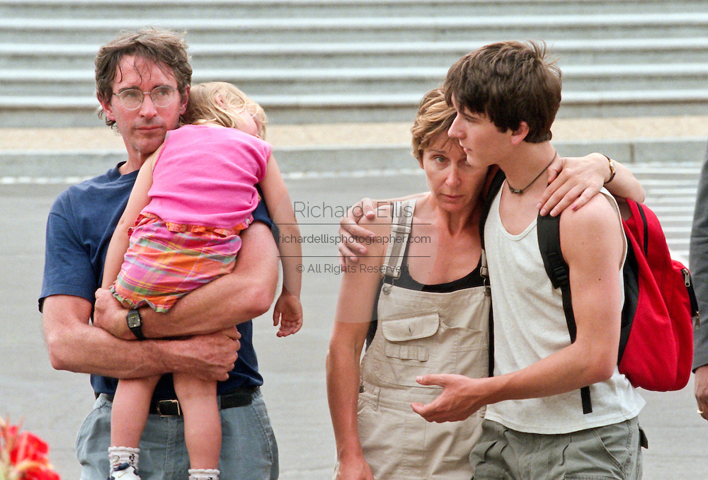 The Majewska family, visiting Washington, DC from Poland, walk from the US Capitol Building after witnessing a gunman opened fire killing two police officers and wounding a civilian July 24, 1998 in Washington, DC. Two US Capitol police officers were killed in the incident, one person wounded and the lone gunmen was wounded and taken into custody.