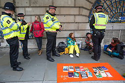 London, UK. 14 October, 2019. City of London police officers arrest climate activists from Extinction Rebellion close to the Bank of England in the City of London on the eighth day of International Rebellion protests.