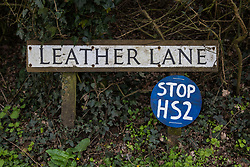 A sign reading 'Stop HS2' is pictured, close to a site in Leather Lane where several hundred-year-old oak trees have been felled to enable the construction of a temporary access road and compound for the HS2 high-speed rail link, on 9th April 2021 in Great Missenden, United Kingdom. Following pressure from local residents, Buckinghamshire Council and the Chilterns Conservation Board, it appears that HS2 contractors have altered their plans in such a way as to preserve some of the trees lining the wildlife-rich ancient country lane.
