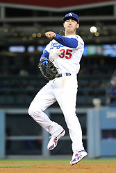 April 13, 2018 - Los Angeles, CA, U.S. - LOS ANGELES, CA - APRIL 13: After making a stellar stop and spin Los Angeles Dodgers First base Cody Bellinger (35) makes a throwing error while trying to throw to first base on April 13, 2018, at Dodger Stadium in Los Angeles, CA.(Photo by Peter Joneleit/Icon Sportswire) (Credit Image: © Peter Joneleit/Icon SMI via ZUMA Press)