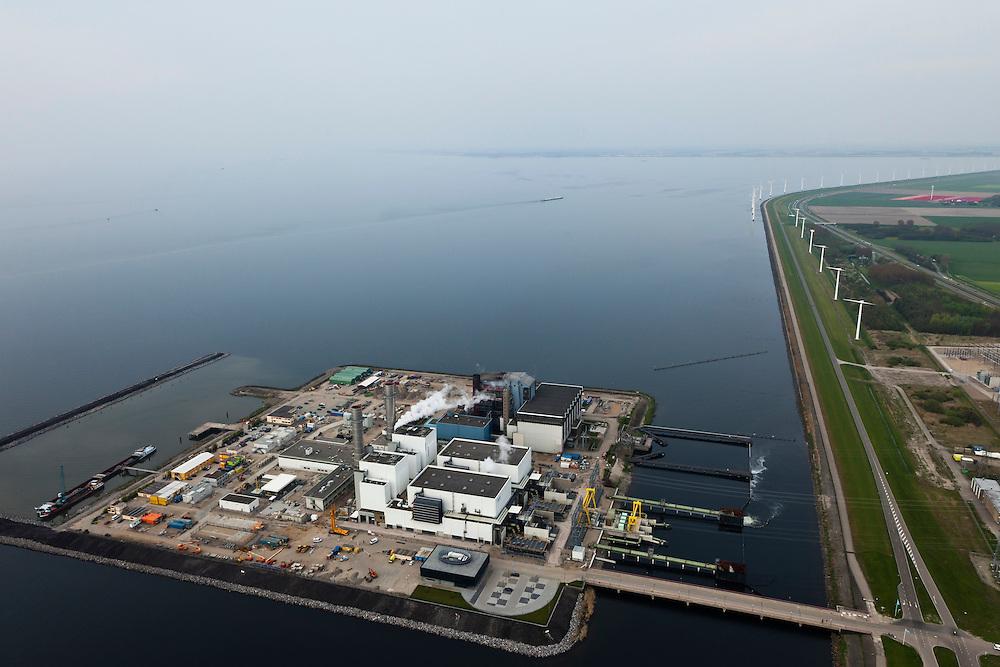 Nederland, Flevoland, Gemeente Lelystad, 28-04-2010. .Maximacentrale (voorheen Flevocentrale) van Electrabel, op een eigen kunstmatig aangelegd eiland in het IJsselmeer. Twee nieuwe  stoom- en gaseenheden (STEG) met aardgas als brandstof, relatief schoon en met hoog-rendement (STEG-eenheden). .Maxima power plant (formerly Flevocentrale) of Electrabel, on its own artificial island in the IJsselmeer. Two new steam and gas units (CCGT) with natural gas as fuel, relatively clean and high-efficiency (combined cycle units)..luchtfoto (toeslag), aerial photo (additional fee required).foto/photo Siebe Swart