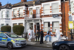 Forensic officers and fire investigators prepare to enter a flat where a 'small, contained' fire in Burnfoot Avenue, Fulham, claimed the life of a woman. Fulham, London. February 07 2018.