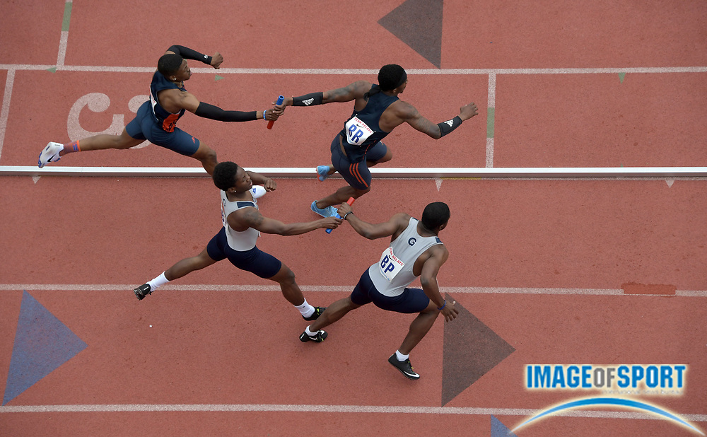 Apr 27, 2018; Philadelphia, PA, USA; Akeem Bloomfield of Auburn takes the handoff from Josh Burns (top) and Nate Alleyne of Georgetown takes baton from Lawrence Leake, Nate Alleyne on the first leg of a 4 x 400m relay heat during the 124th Penn Relays at Franklin Field. Auburn was the top qualifier in 3:07.72.