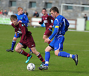 Brian Gafney Galway  chases James Scanlon Wicklow  in Drom  in the  Youths Cup final . Phorto : Andrew Downes
