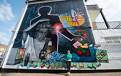 A 9 metre George Michael mural painted in Kingsbury by artist Dawn Mellor, North West London, Great Britain <br /> Unveiled 17th September 2020    <br /> <br /> Artist Dawn Mellor looks up at her large-scale mural that celebrates the life of local hero George Michael who was a 1st year pupil at Kingsbury High School in 1974. <br /> Commissioned as part of the Brent supported by the Brent Borough of Culture 2020 fund. <br /> <br /> Photograph by Elliott Franks