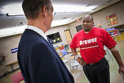"""06 OCTOBER 2010 - PHOENIX, AZ: Terry Goddard (CQ) LEFT talks to Anthony Miller (CQ), who wore a Jan Brewer tee shirt, during a town hall style campaign meeting at Pecos Community Center in the Ahwatukee section of Phoenix. Miller wanted to know why Goddard had not opposed the recently passed health care reform law, which Miller derisively called """"Obamacare.""""  Goddard lost the election to sitting Governor Jan Brewer, a conservative Republican.     PHOTO BY JACK KURTZ"""