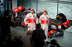 """© London News Pictures. 31/01/2013 . Woking, UK.  Team McLaren Mercedes drivers Jenson Button (left) and Sergio """"Checo"""" Perez (right) pose for photographers at the unveiling of the new MP4-28 Formula 1 car at the McLaren Technology Centre in Woking, Surrey, UK  on  Thursday, Jan. 31, 2013. Photo credit : Ben Cawthra/LNP"""