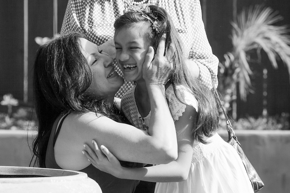 Veronica Ramirez kisses Bella after she sang at Nikko's memorial. After Nikko's death, Bella joined a singing group that focused on traditional Mexican folk songs, many of which have lyrics about loss. Ramirez said performing music had been healing for her daughter.