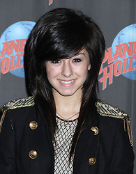 June 11, 2016 - File - CHRISTINA GRIMMIE, a singer known for competing on The Voice, died Friday night after she was shot after a concert in Orlando. Grimmie and the pop/punk band Before You Exit were signing autographs and selling merchandise after their show at the Plaza Live Theater when a man walked up to her and shot her, Grimmie's brother tackled him. The suspect then shot himself. Pictured: June 14, 2011 - New York, New York, U.S. - YouTube sensation singer Christina Grimmie visits Planet Hollywood -Times Square. (Credit Image: © Nancy Kaszerman/ZUMAPRESS.com)