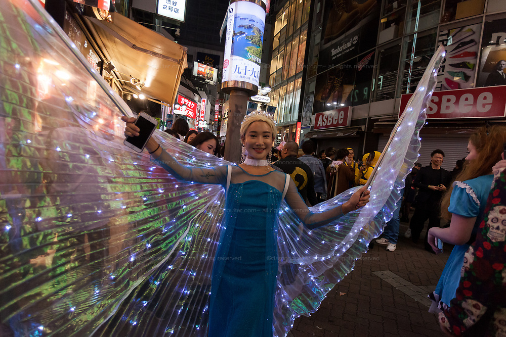 A Japanese woman in a Frozen costume during the Halloween celebrations Shibuya, Tokyo, Japan. Saturday October 27th 2018. The celebrations marking this event have grown in popularity in Japan recently. Enjoyed mostly by young adults who like to dress up, drink , dance and misbehave in parts of Tokyo like Shibuya and Roppongi. There has been a push back from Japanese society and the police to try to limit the bad behaviour.