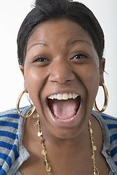 Studio portrait of a teenage girl laughing,