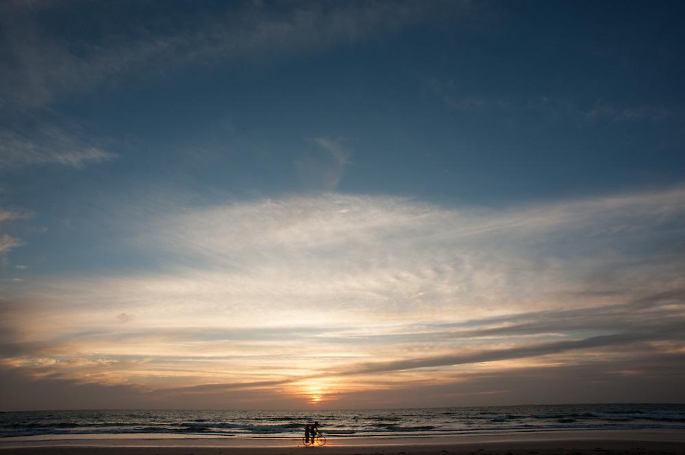 Bicycle on Ngwesaung beach at dusk (Myanmar)