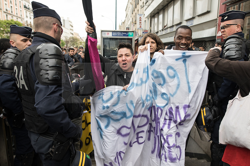 © Licensed to London News Pictures. 16/04/2017. Paris, France. Antifascist protesters opposed to a meeting by French far-right party , Front National , hold a demonstration and march through North East of Paris . Photo credit: Joel Goodman/LNP