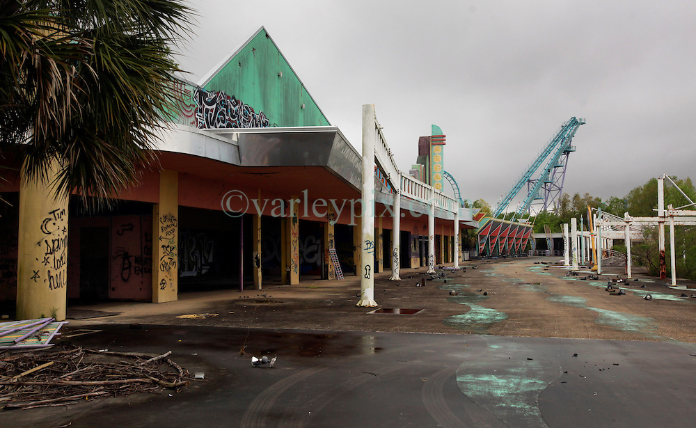 15 April 2016. New Orleans, Louisiana.<br /> Abandoned Six Flags amusement park in New Orleans East.<br /> Not amusing any more. <br /> 'Closed for storm.' Six Flags former amusement park radiates an eerie post apocalyptic sense of foreboding in it's abandonment. The park was destroyed by hurricane Katrina in August 2005, stripped by copper thieves and is slowly being reclaimed by the land it stands on. The site is now home to thriving wildlife. Would be developers for the former Jazzland site have proposed various ideas over the years to revive the area into a theme park and shopping complex, proposals which have been rejected by the Industrial Development Board. <br /> Photo; Charlie Varley/varleypix.com