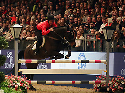 Sir Anthony McCoy competes in the Markel Champions Challenge in aid of the Injured Jockeys Fundduring day four of the London International Horse Show at London Olympia.