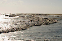 Rough winter seas caused by a passing nor'easter tear into the beaches of Cape May, NJ.