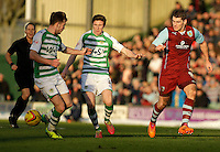 Burnley's Sam Vokes plays the ball past Yeovil Town's John Lundstram.<br /> <br /> Photo by James Marsh/CameraSport<br /> <br /> Football - The Football League Sky Bet Championship - Yeovil Town v Burnley - Saturday 11th January 2014 - Huish Park - Yeovil<br /> <br /> © CameraSport - 43 Linden Ave. Countesthorpe. Leicester. England. LE8 5PG - Tel: +44 (0) 116 277 4147 - admin@camerasport.com - www.camerasport.com