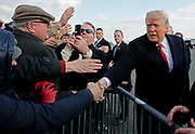 U.S. President Donald Trump greets a crowd outside the Philadelphia airport prior to attending the 119th U.S. Army-Navy football game in Philadelphia, Pennsylvania.   REUTERS/Jim Young