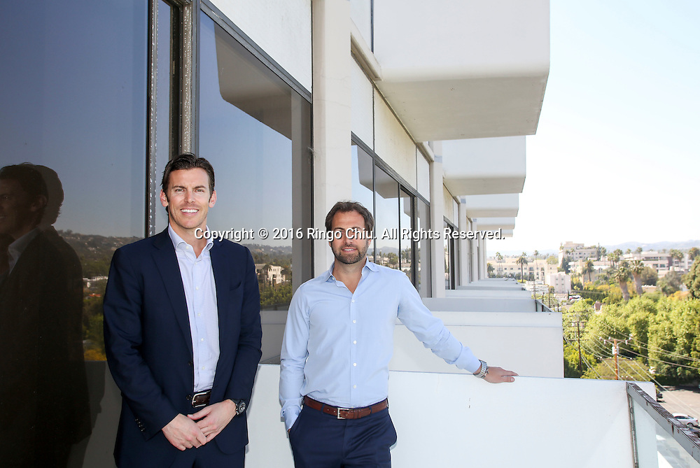 Tyler Siegel, right, and John Irwin from Townscape Partners in the building at 8899 Beverly Blvd. West Hollywood. <br />  (Photo by Ringo Chiu/PHOTOFORMULA.com)<br /> <br /> Usage Notes: This content is intended for editorial use only. For other uses, additional clearances may be required.
