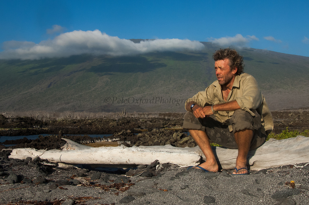Pete Oxford<br /> Wolf Volcano, Isabela Island, GALAPAGOS ISLANDS<br /> ECUADOR.  South America<br /> In December 2008 a team of Galapagos National Park Guards, Scientiests and Vets spent 2 weeks on the volcano capturing 1663 Giant Tortoises to take blood samples and biometric data. The blood was sent to the USA for DNA analysis. Object to look for Pinta female for Lonesome George.  Distinct saddleback forms like Lonesome George found. Also Floreana genes were previously found. There seems to be a mixed gene pool possible from tortoises swimming ashore from ship wrecks etc.