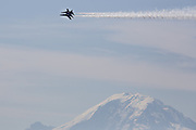 The U.S. Navy Blue Angels practice their routine over Mount Rainier, as viewed from Homer M. Hadley Memorial Bridge in Seattle, Washington. (Maddie Meyer / The Seattle Times, 2014)