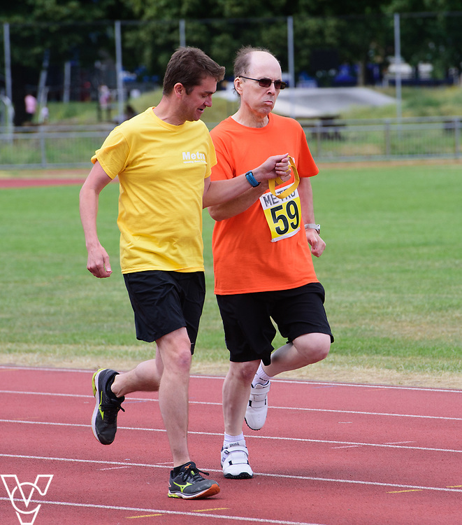 Event: 200 meters<br /> Competitors, from left: Colin Chandler<br /> <br /> Metro Blind Sport's 42nd Athletics Open, held at Mile End Stadium, Tower Hamlets, London.<br /> <br /> Picture: Chris Vaughan Photography for Metro Blind Sports<br /> Date: June 16, 2018