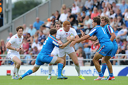 James Rodwell of England is challenged by Matteo Falsaperla of Italy - Photo mandatory by-line: Dougie Allward/JMP - Mobile: 07966 386802 - 11/07/2015 - SPORT - Rugby - Exeter - Sandy Park - European Grand Prix 7s
