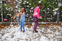 © Licensed to London News Pictures. 28/08/2016. London, UK. Children play with snow-like foam during a parade on family day of Notting Hill Carnival in west London, Sunday, 28 August 2016. Photo credit: Tolga Akmen/LNP