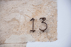 Close up detail house number wall thirteen metal