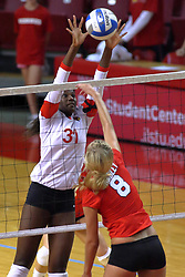 09 October 2009: Hailey Kelley rises to defend a strike by Megan Schmidt. The Redbirds of Illinois State defeated the Braves of Bradley in 3 sets during play in the Redbird Classic on Doug Collins Court inside Redbird Arena in Normal Illinois