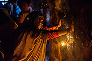 """19th November 2015, New Delhi, India.  A woman prays at a shrine dedicated to Djinn worship in the ruins of Feroz Shah Kotla in New Delhi, India on the 19th November 2015<br /> <br /> PHOTOGRAPH BY AND COPYRIGHT OF SIMON DE TREY-WHITE a photographer in delhi<br /> + 91 98103 99809. Email: simon@simondetreywhite.com<br /> <br /> People have been coming to Firoz Shah Kotla to pray to and leave written notes and offerings for Djinns in the hopes of getting wishes granted since the late 1970's. Jinn, jann or djinn are supernatural creatures in Islamic mythology as well as pre-Islamic Arabian mythology. They are mentioned frequently in the Quran  and other Islamic texts and inhabit an unseen world called Djinnestan. In Islamic theology jinn are said to be creatures with free will, made from smokeless fire by Allah as humans were made of clay, among other things. According to the Quran, jinn have free will, and Iblīs abused this freedom in front of Allah by refusing to bow to Adam when Allah ordered angels and jinn to do so. For disobeying Allah, Iblīs was expelled from Paradise and called """"Shayṭān"""" (Satan).They are usually invisible to humans, but humans do appear clearly to jinn, as they can possess them. Like humans, jinn will also be judged on the Day of Judgment and will be sent to Paradise or Hell according to their deeds. Feroz Shah Tughlaq (r. 1351–88), the Sultan of Delhi, established the fortified city of Ferozabad in 1354, as the new capital of the Delhi Sultanate, and included in it the site of the present Feroz Shah Kotla. Kotla literally means fortress or citadel."""