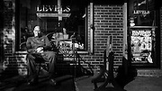 Charles sitting outside Levels Barber Shop, Fulton Street, Brooklyn, NY