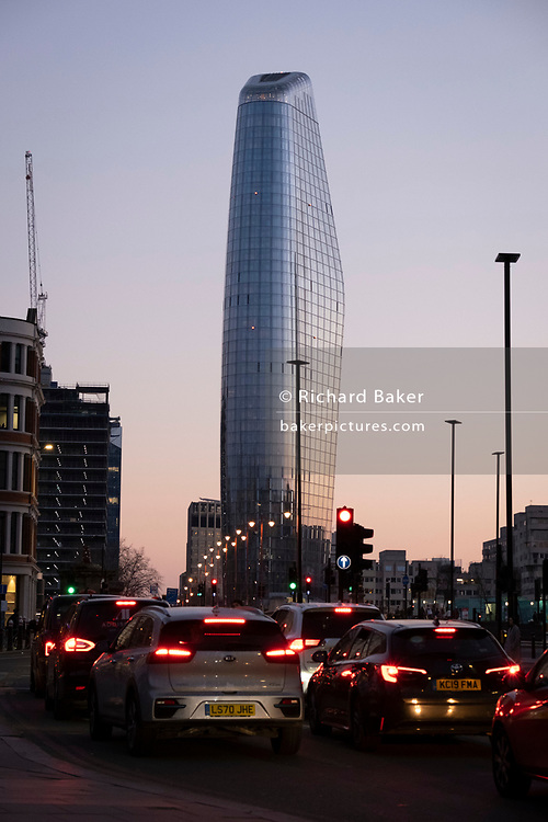 Seen from the City of London, One Blackfriars (one of the capital's newest skyscrapers) rises above evening rush-hour traffic, on 27th February 2021, in London, England. Located on Bankside, the south bank of the river Thames, the development is a 52-storey 170m tower whose uses include residential flats, a hotel and retail.