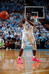 CHAPEL HILL, NC - FEBRUARY 05: Nassir Little #5 of the North Carolina Tar Heels passes the ball during a game against the North Carolina State Wolfpack on February 05, 2019 at the Dean Smith Center in Chapel Hill, North Carolina. North Carolina won 113-96. North Carolina wore retro uniforms to honor the 50th anniversary of the 1967-69 team. (Photo by Peyton Williams/UNC/Getty Images) *** Local Caption *** Nassir Little