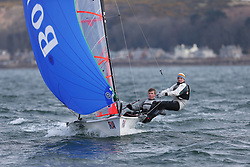 Day 1 of the RYA Youth National Championships 2013 held at Largs Sailing Club, Scotland from the 31st March - 5th April. ..704, Barnaby BLACKSTONE, Guy WILKINSON, HISC, 29er..For Further Information Contact..Matt Carter.Racing Communications Officer.Royal Yachting Association.M: 07769 505203.E: matt.carter@rya.org.uk ..Image Credit Marc Turner / RYA..