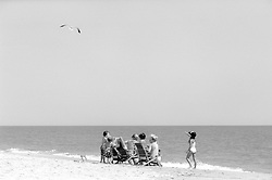 Unidentified children frolic on the edge of the Atlantic Ocean at the Henlopen Acres Beach Club in Rehoboth Beach, Del., Monday, Aug. 19, 2019. (Photo by D. Ross Cameron)