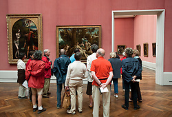 Tour group looking at paintings inside Gemaldegalerie art museum at the Kulturform complex in Berlin Germany
