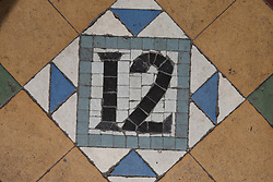 Number 12 in tiles.