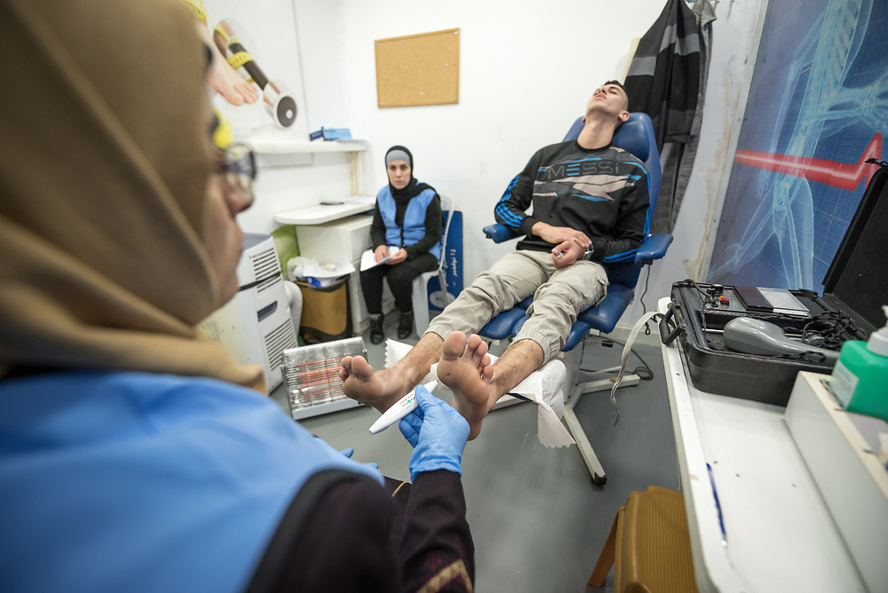 26 February 2020, Abu Dis, Palestine: nurse Amal Abu-Ghanam carries out a foot exam of 16-year-old Diabetes patient Abdel Rahman. Here, through a monofilament sensitivity test. In an effort to make Diabetes services more accessible to people in the West Bank, the Augusta Victoria Hospital offers a Mobile Diabetes Clinic, which moves around to various locations in the West Bank, offering screening and routine testing for Diabietes and the symptoms it causes.