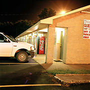 Motel shot at night on the outskirts of Vicksburg, Mississippi. Part of the attraction of a road trip is just hitting the tarmac and seeing where you will end up. When the budget doesn't run to a fabulous hotel you can always plump for rough and ready and possibly film noir at the thousands of bargain priced motels around the states. One can normally get clean sheets and a comfortable bed for the night but if not it all adds to the classic road trip experience.