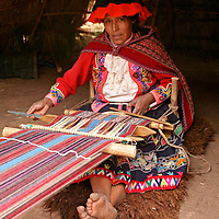 Americas, South America, Peru, Cusco. Woman waeving at Awana Kancha.