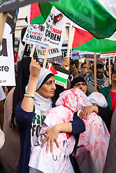 "London, August 23rd 2014. Women display ""dead babies"" symbolising the many children killed since Israel's Operation Protective Edge began, as hundreds of pro- Palestine protesters demonstrate outside Downing Street demanding that Britain stops arming Israel."