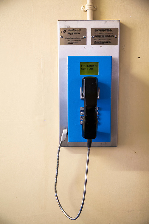 A prison payphone mounted to a wall outside of the visits room in HM Prison Brixton, a local men's prison located in Brixton in the borough of Lambeth in South London on the 26th of July 2016, London United Kingdom. The prison originally opened as the Surrey House of Correction in 1820 and now has a capacity of 800 men living across 5 different wings. A, B, C, D and G, G wing houses vulnerable men. (photo by Andy Aitchison)